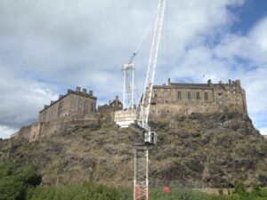 Photo of the office window view showing Edinburgh Castle obscured by a crane