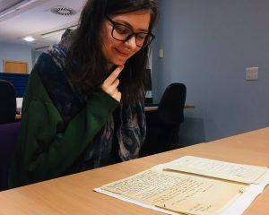Archives cataloguing volunteer, Tara Copic, reading one of her favourite discoveries from the Patrick Geddes correspondence, a letter from Frank C. Mears to Patrick Geddes, 1908.