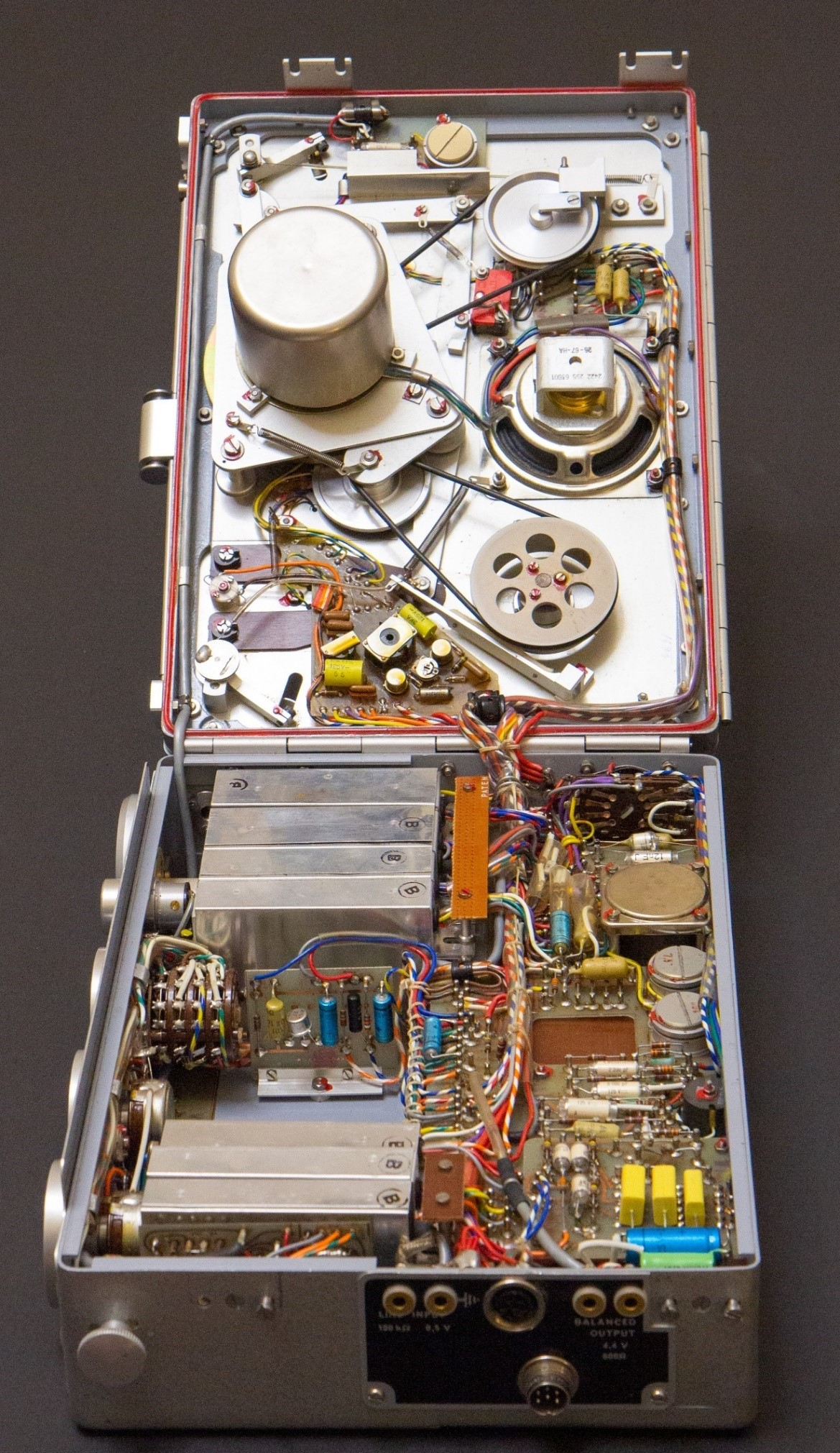 what the Nagra looks like inside the machine. There are many coloured wireds, cogs and components