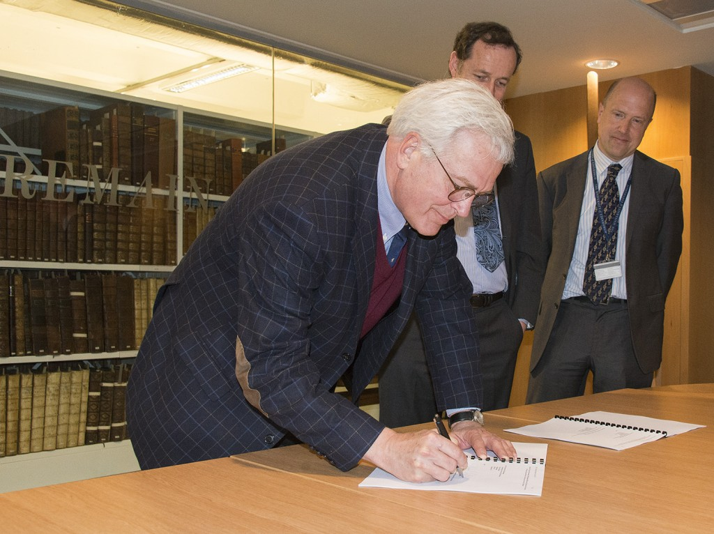 Mike Keller, the Stanford University Librarian signing the IIIF agreement with Gavin McLachlan and Jeremy Upton in the Treasures Viewing Room, 26th April 2016